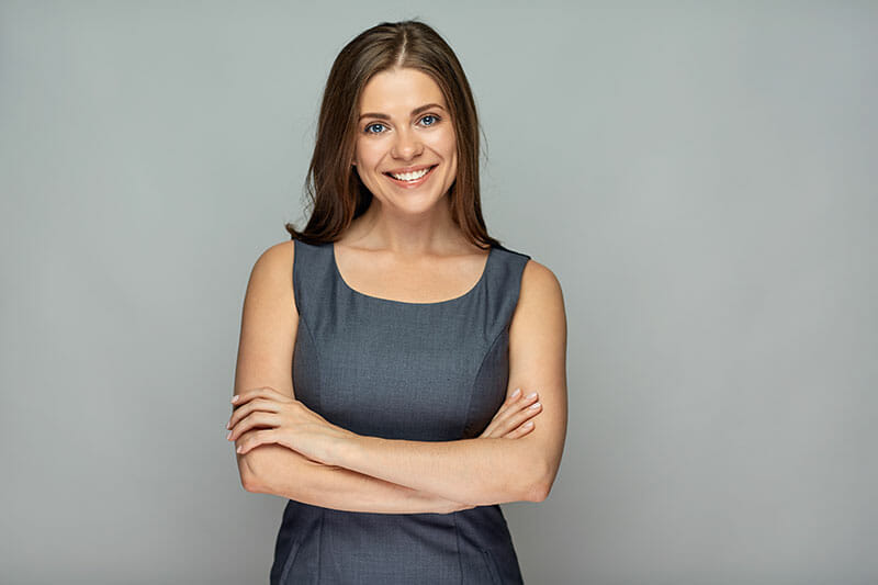 girl smiling with crossed arms